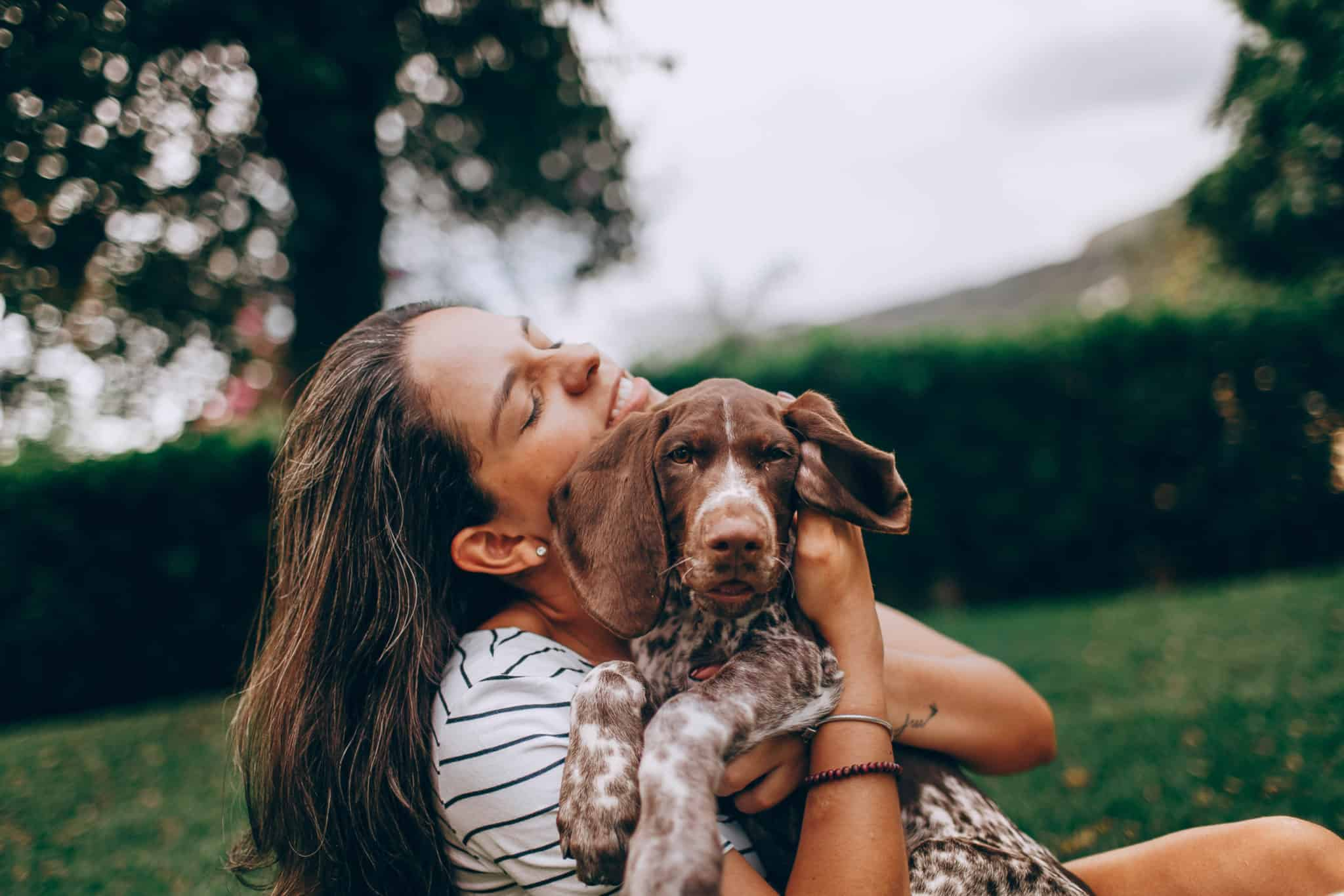 Woman hugging her puppy
